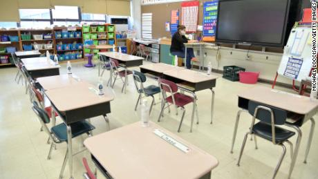 صورة In new Covid-19 guidance, CDC recommends 5 key strategies to reopen schools